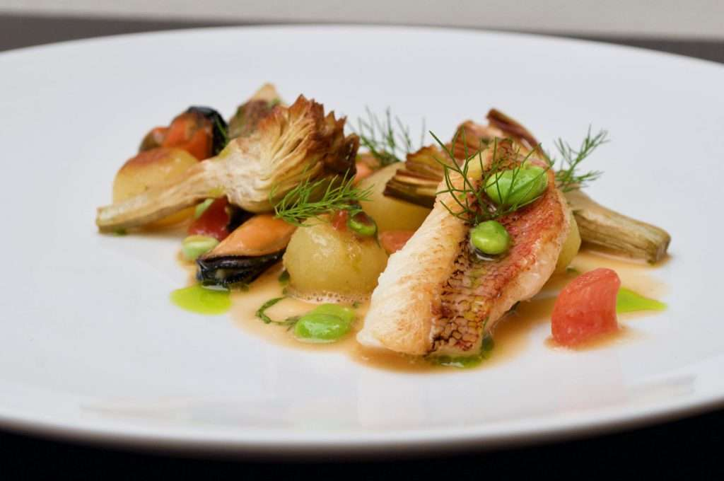 Rascasse with mussels and artichokes